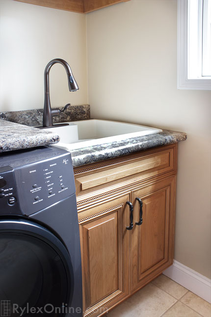 Laundry Room With Utility Cabinet